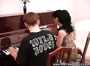 Mature powered piano teacher fucking her partisan