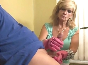Grown-up girl gloved handjob