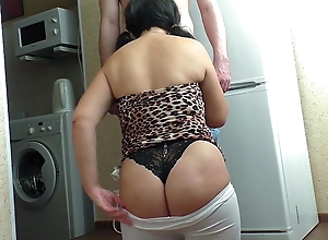 An adult lady knelt for a Blowjob before the son of a friend